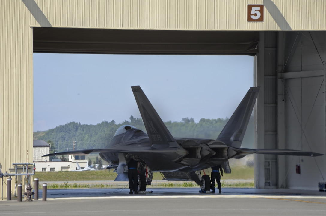 Crewmembers work on an F-22 Raptor from the 525 Fighter Squadron, after it returns from a mission during exercise Northern Edge 2015 at Joint Base Elmendorf-Richardson, Alaska, June 18, 2015. Northern Edge is Alaska's premier joint training exercise designed to practice operations, techniques and procedures, as well as enhance interoperability among the services. (U.S. Air Force photo/Staff Sgt. William Banton)
