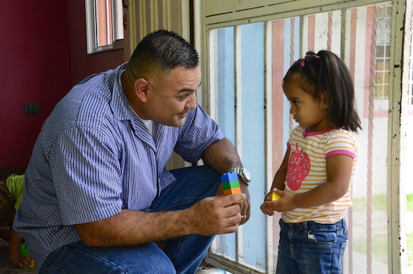 Master Sgt. Roberto Vasquez, the superintendent of 12th Air Force (Air Forces Southern)  Plans, Requirements, and Programs section, plays with a young girl at Casa de Corderitos orphanage outside the city of Tegucigalpa, Honduras, June 18, 2015. Members from 12th Air Force (AFSOUTH) spent some of their downtime during a three-day assessment visit to Honduras air bases to volunteer with the local community and to deliver toys and candy that were donated by businesses in Tucson, Ariz. (U.S. Air Force photo/Tech. Sgt. Heather R. Redman)