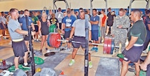 Soldiers watch as another Soldier lifts weight June 10 at Craig Fitness Center. Soldiers of 1st Bn., 5th FA Regt., 1st ABCT, 1st Inf. Div., hosted a weightlifting competition.