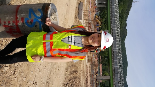 Gu Gui-young, a senior at Yeungnam University majoring in materials science and engineering and an intern at the Far East District's southern resident, on site at the middle and high school project at Camp Walker.