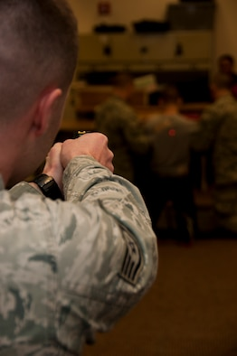 Staff Sgt. Nicholas Alexander administers the taser while members of the 179th Airlift Wing Security Forces Squadron are training on less than lethal methods in Mansfield, OH, Feb. 08, 2015. . (U.S. Air National Guard Photo by Tech. Sgt. Joe Harwood\Released)