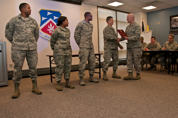 The 179th Airlift Wing Recruiting, Mansfield, OH, is recognized by the Wing Commander, Col. Gary McCue, Feb.06, 2015. The team took home nine Recruiting and Retention Awards this year including the most accessions in the nation for the fiscal year.  (U.S. Air National Guard Photo by Tech. Sgt. Joe Harwood\Released)