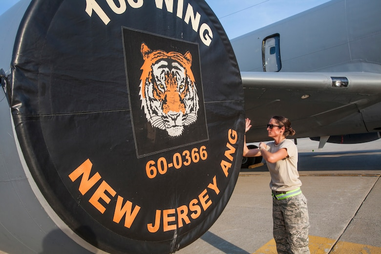 Senior Airman Ashley V. Chytraus, a crew chief with the 108th Wing, New Jersey Air National Guard, attaches an engine cover on a KC-135R Stratotanker at Joint Base McGuire-Dix-Lakehurst, N.J., June 11, 2015. Chytraus was in a motorcycle accident June 21, 2014. The collision broke two vertebrae in Chytraus's neck, crushed her hand, mangled the quadriceps tendon in her leg, forced two splintered ribs into her liver and fractured her elbow. In addition, she died while being medevaced to the hospital. 358 days later, she passed all portions of the Air Force Physical Fitness Test and received an excellent. (U.S. Air Force photo by Master Sgt. Mark C. Olsen/Released)