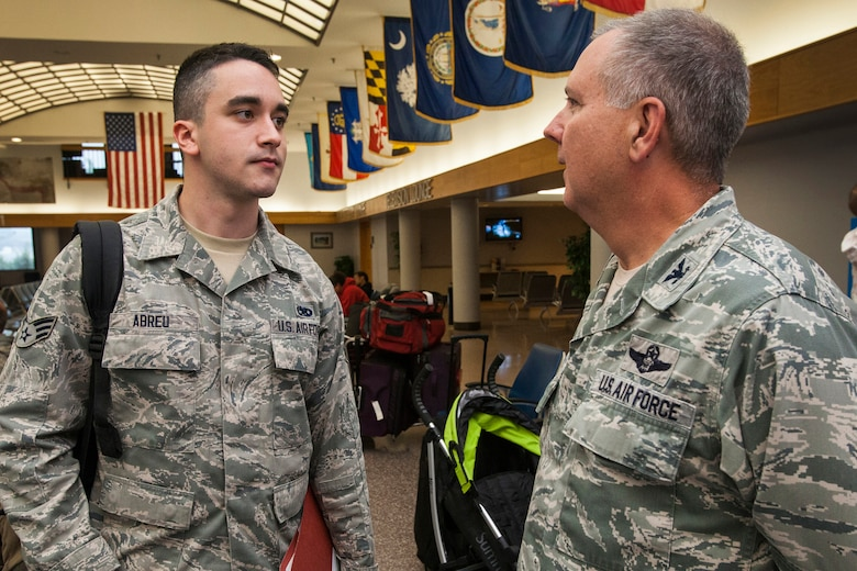 Col. Robert A. Meyer, Jr., right, commander, 108th Wing, New Jersey Air National Guard, has a discussion with Senior Airman David Abreu at the passenger terminal at Joint Base McGuire-Dix-Lakehurst, N.J., June 2, 2015. Approximately 50 Airmen from the 108th Wing deployed to the Central Command area of responsibility in support of Operations Enduring Freedom and Freedom's Sentinel. (U.S. Air National Guard photo by Master Sgt. Mark C. Olsen/Released) (This image was cropped to focus on the subject of the image)
