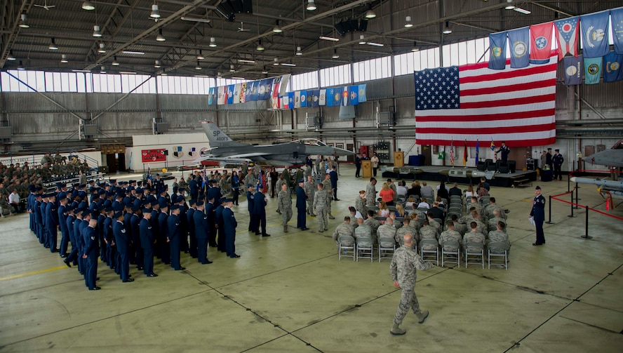 Members of the Spangdahlem community attend the 52 MXG change of command ceremony in hangar one on Spangdahlem Air Base, Germany, June 18, 2015. Base leadership, honorary base commanders, local nationals and friends and families of the outgoing MXG commander were also in attendance. (U.S. Air Force photo by Airman 1st Class Timothy Kim/Released)
