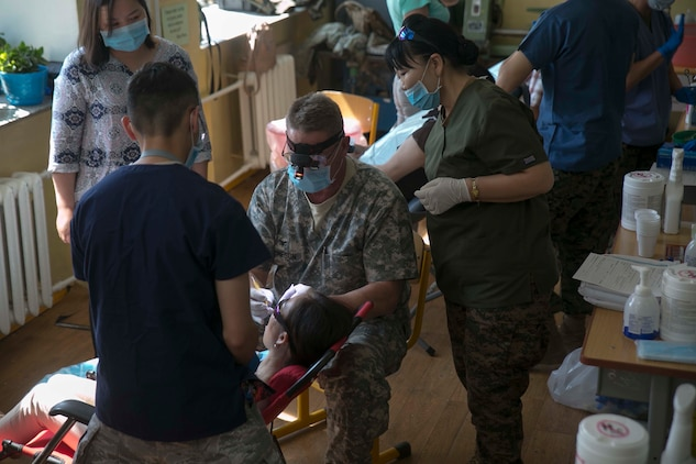 Mongolian and U.S. service members provide dental care for Mongolian residents as part of the health services support engagement during Khaan Quest 2015 at the 79th High School in Ulaanbaatar, Mongolia, June 21. Khaan Quest is a regularly scheduled, multinational exercise hosted annually by the Mongolian Armed Forces and co-sponsored by U.S. Army, Pacific, and U.S. Marine Corps Forces, Pacific.