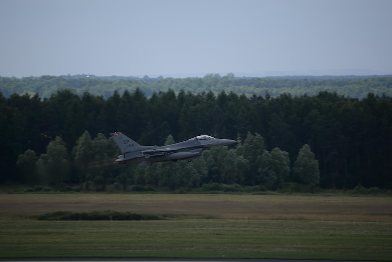 An F-16 Fighting Falcon takes off in support of NATO exercise Eagle Talon June 15, 2015. Forces from the South Carolina Air National Guard's 52nd Fighter Wing and the 32nd Tactical Wing from Poland focused on offensive air operations and command and control exercises. The training missions paired U.S. fighter pilots and maintenance crews with their Polish Air Force counterparts at Lask Air Base, Poland, and helped strengthen relationships. (U.S. Air Force photo/Senior Master Sgt. Wesley Fleming )