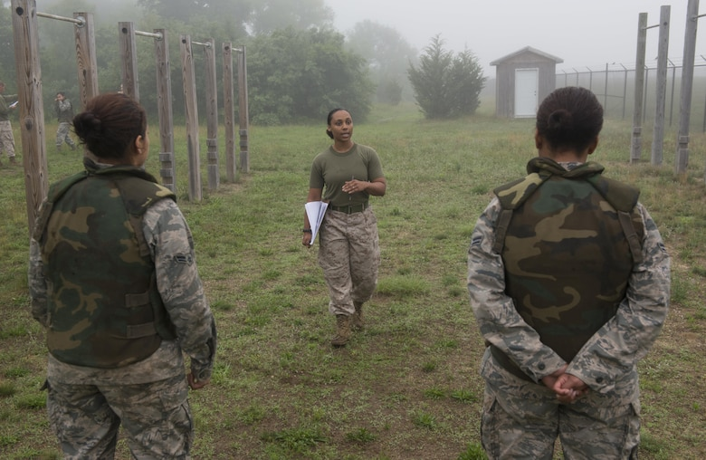 Marine Sgt. Teliah Wilson, the Marine Aircraft Group 49 adjutant and Marine Corps Martial Arts Program course instructor, explains the tan belt MCMAP test to Airmen on Joint Base McGuire-Dix-Lakehurst, N.J., June 16, 2015. Ten Airmen took and passed the course. (U.S. Air Force photo/Airman 1st Class Joshua King)