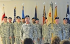 New HHC USAG commander Capt. David Grindle stands with his new unit after a change of command ceremony June 4.