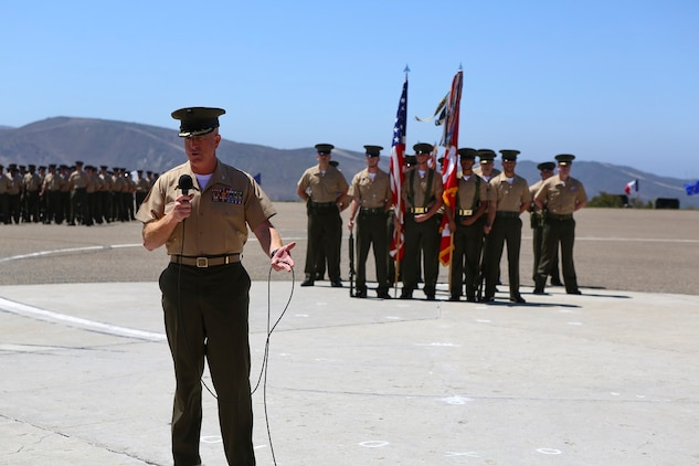 Colonel Kenneth R. Kassner speaks after taking command of the 5th Marine Regiment from Col. Jason Q. Bohm aboard Marine Corps Base Camp Pendleton, Calif., June 24, 2015. Kassner most recently served as the assistant chief of staff, programming and requirements, U.S. Marine Corps Forces Special Operations Command.