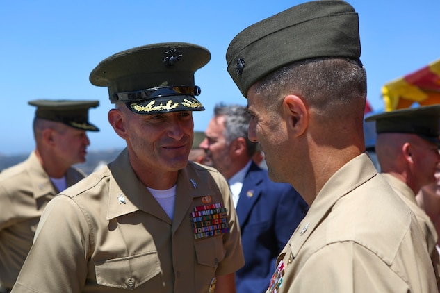 Colonel Jason Q. Bohm is congratulated by Marines and Sailors after relinquishing his role as the commanding officer of the 5th Marine Regiment to Col. Kenneth R. Kassner aboard Marine Corps Base Camp Pendleton, Calif., June 24, 2015. Kassner most recently served as the assistant chief of staff, programming and requirements, U.S. Marine Corps Forces Special Operations Command.
