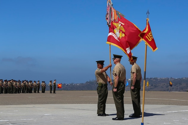 Colonel Jason Q. Bohm relinquishes his role as the commanding officer of the 5th Marine Regiment to Col. Kenneth R. Kassner aboard Marine Corps Base Camp Pendleton, Calif., June 24, 2015. Kassner most recently served as the assistant chief of staff, programming and requirements, U.S. Marine Corps Forces Special Operations Command.