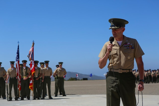 Colonel Jason Q. Bohm speaks after relinquishing his role as the commanding officer of the 5th Marine Regiment to Col. Kenneth R. Kassner aboard Marine Corps Base Camp Pendleton, Calif., June 24, 2015. Kassner most recently served as the assistant chief of staff, programming and requirements, U.S. Marine Corps Forces Special Operations Command.