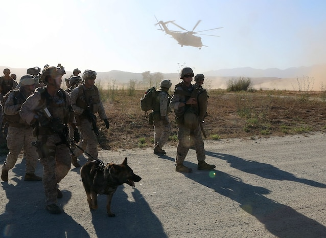 Marines with 1st Explosive Ordnance Disposal Company, 1st Marine Logistics Group, I Marine Expeditionary Force, disembark a CH-53 Super Stallion helicopter and move to their mission objective, where they were tasked with destroying ordnance fired at a foreign embassy during a training exercise aboard Camp Pendleton, Calif., June 17, 2015. The Marines of 1st EOD Co. are preparing for an upcoming deployment with Special Purpose Marine Air Ground – Crisis Response – Central Command, where they will participate in a fast reaction force role.