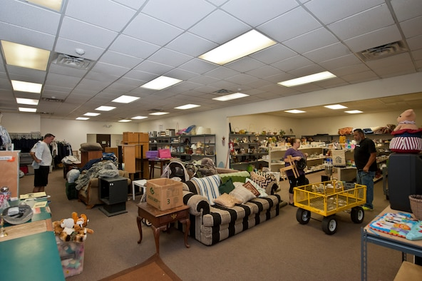 Patrons at the Airman's Attic look through the store's inventory on Nellis Air Force Base, Nev., June 18,2015. The Airman's Attic is a volunteer-based organization where Airmen of all ranks can turn in or pick up military uniform items, and Airmen E-5 and below can score anything from a book to a TV; all for free. (U.S. Air Force photo by Airman 1st Class Jake Carter)