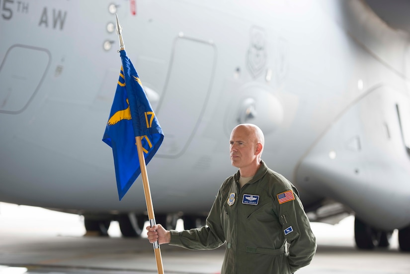 Chief Master Sgt. John Gallo bears the guidon during the 17th Airlift Squadron's inactivation ceremony June 25, 2015 at Joint Base Charleston, S.C. As part of the President's Defense Budget for FY15, one of Charleston's four active-duty C-17 flying squadron's was designated for inactivation. In attendance at the ceremony were many of the squadron's former commander's including Maj. Gen. (ret) Ron Ladnier, who commanded the squadron when it stood up as the first operational C-17 squadron. Gallo is the 17th AS superintendent. (U.S. Air Force photo / Trisha Gallaway)