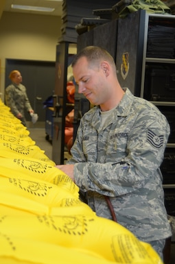 Tech. Sgt. James Eder, a member of the 126th Operations Life Support shop assigned to the 126th Air Refueling Wing, fills life vests with air to check for leaks at Scott Air Force Base, Il., June 17, 2015. The vests are used on the KC-135 Stratotankers in case of an emergency water landing. (Air National Guard photo by Senior Airman Elise Stout)