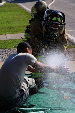 Airmen of the Ohio Air National Guard work with the Richland County Emergency Management Agency (EMA) during an exercise at the 179th Airlift Wing, Mansfield, OH, April 29, 2015. The county-wide hazardous material response exercise evaluates coordination of law enforcement, fire departments and emergency service agencies from the local area working together in a joint scenario. (U.S. Air National Guard Photo by Tech. Sgt. Joe Harwood\Released)
