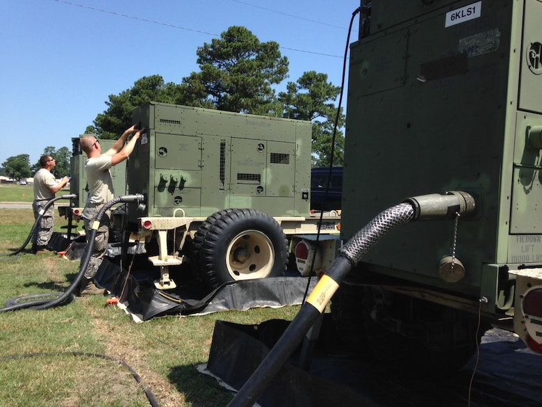 "U.S. Air Force Senior Airman Tyler Morton of Mooresville, N.C. and Staff Sgt. Chris Wallace of Greenville, N.C. power production technicians for the 263rd Combat Communications Squadron, New London, N.C. monitor critical systems on a bank of electric generators June 15, 2015 at Seymour Johnson Air Force Base, Goldsboro, N.C. The airmen and their team set up the generators to power the unit's sophisticated communications gear and climate-control equipment during exercise ""Medusa Rising,"" which tested their ability to supply communication services to customers when deployed. (U.S. Air Force photo by Lt. Col. Robert Carver, North Carolina Air National Guard Public Affairs/Released)"