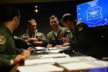 Aircrew from the 96th Bomb Squadron have a discussion after a pre-departure briefing for Exercise Northern Edge 2015 on Barksdale air Force Base, La., June 22, 2015. Northern Edge is a joint training exercise involving all military branches and prepares joint forces to respond to crises in the Indo-Asia-Pacific region. (U.S. Air Force photo/Airman 1st Class Luke Hill)