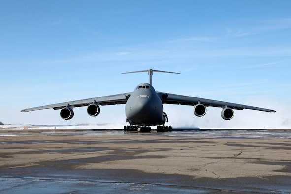 Members of the 179th Airlift Wing prepare to unload a C-5M Super Galaxy out of Dover Air Force Base, Del., as it lands in Mansfield, Ohio. Coast Guard members from Port Security Unit 309 in Port Clinton, Ohio, are returning from a training missison Mar. 3, 2015. The Coast Guard is working with the Air Force and the Air Guard for logistics assistance to move boats and members of the Coast Guard during a training mission. (U.S. Air National Guard Photo by Master Sgt. Lisa Haun\Released)