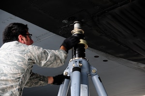 U.S. Air Force Staff Sgt. Alejandro Armendariz, 145th Maintenance Squadron, seats a jack to the wing of a C-130 Hercules aircraft while other maintainers position new Isochronal Inspection (ISO) Aircraft Maintenance Platforms around the aircraft at the North Carolina Air National Guard base, Charlotte Douglas International Airport, June 2, 2015. (U.S. Air National Guard photo by Master Sgt. Patricia F. Moran, 145th Public Affairs/Released)