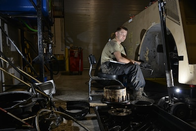 Senior Airman Ryan Marney sits by an aircraft towing vehicle during routine maintenance June 24, 2015 Al Udeid Air Base, Qatar. Marney is assigned to the 379th Expeditionary Logistics Readiness Squadron vehicle operations, deployed out of the 20th Logistics Readiness Squadron, Shaw Air Force Base, S.C..(U.S. Air Force photo/ Staff Sgt. Alexandre Montes)
