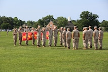 Platoon commanders and guides render a salute to the Commander of Troops and staff during Chief Warrant Officer 5 Nicholas V. Vitale's retirement ceremony June 18, 2015, at W.P.T. Hill Field, Marine Corps Base Camp Lejeune, North Carolina. Vitale retired after serving more than 30 years in the Marine Corps. (U.S. Marine Corps photo by Sgt. Alicia R. Leaders/Released)