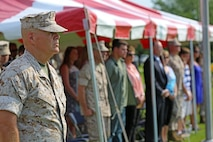 Lt. Gen. Robert B. Neller, commander of Marine Corps Forces Command, takes his position in the reviewing area in preparation for the parade to honor the reviewing officer during Chief Warrant Officer 5 Nicholas V. Vitale's retirement ceremony June 18, 2015, at W.P.T. Hill Field, Marine Corps Base Camp Lejeune, North Carolina. Neller served as a mentor throughout Vitale's career, and was the reviewing officer for his ceremony. Vitale retired after serving more than 30 years of service in the Marine Corps. (U.S. Marine Corps photo by Alicia R. Leaders/Released)