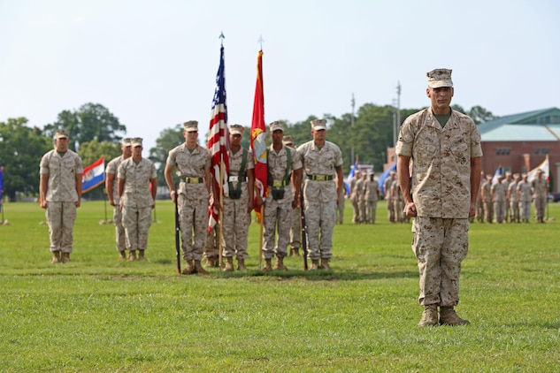 Chief Warrant Officer 5 Nicholas V. Vitale, right, Ground Combat Element Integrated Task Force Gunner, waits to be decorated during his retirement ceremony June 18, 2015, at W.P.T. Hill Field, Marine Corps Base Camp Lejeune, North Carolina. Vitale retired after serving more than 30 years of service in the Marine Corps. (U.S. Marine Corps photo by Alicia R. Leaders/Released)