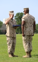 Chief Warrant Officer 5 Nicholas V. Vitale, right, Ground Combat Element Integrated Task Force Gunner, returns a salute to 1st Sgt. John D. Borders, first sergeant of Headquarters and Service Company, GCEITF, after presenting the national flag to Vitale during his retirement ceremony June 18, 2015, at W.P.T. Hill Field, Marine Corps Base Camp Lejeune, North Carolina. The flag was flown over Camp Wilson, Marine Corps Air Ground Combat Center Twentynine Palms, California, April 29, 2015, while Marines were conducting the Marine Corps Operational Test and Evaluation Activity assessment. Vitale retired after serving more than 30 years of service in the Marine Corps. (U.S. Marine Corps photo by Alicia R. Leaders/Released)