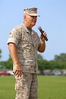Lt. Gen. Robert B. Neller, commander of Marine Corps Forces Command, speaks to attendees of Chief Warrant Officer 5 Nicholas V. Vitale's retirement ceremony June 18, 2015, at W.P.T. Hill Field, Marine Corps Base Camp Lejeune, North Carolina. Neller served as a mentor throughout Vitale's career, and was the reviewing officer for his ceremony. Vitale retired after serving more than 30 years of service in the Marine Corps. (U.S. Marine Corps photo by Alicia R. Leaders/Released)