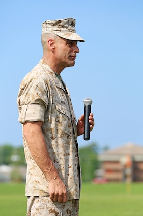 Chief Warrant Officer 5 Nicholas V. Vitale, Ground Combat Element Integrated Task Force Gunner, addresses the Marines, his family and friends in attendance of his retirement ceremony June 18, 2015, at W.P.T. Hill Field, Marine Corps Base Camp Lejeune, North Carolina. Vitale retired after serving more than 30 years of service in the Marine Corps. (U.S. Marine Corps photo by Alicia R. Leaders/Released)