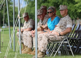 Lt. Gen. Robert B. Neller, commander of Marine Corps Forces Command, right, Maj. Gen. Brian D. Beaudreault, center, commanding general of 2nd Marine Division, and other distinguished guests listen to Chief Warrant Officer 5 Nicholas V. Vitale's remarks at his retirement ceremony June 18, 2015, at W.P.T. Hill Field, Marine Corps Base Camp Lejeune, North Carolina. Neller served as a mentor throughout Vitale's career, and was the reviewing officer for his ceremony. Vitale retired after serving more than 30 years of service in the Marine Corps. (U.S. Marine Corps photo by Alicia R. Leaders/Released)