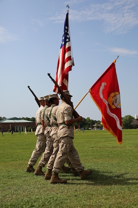 The Ground Combat Element Integrated Task Force color guard presents the colors to Lt. Gen. Robert B. Neller, Marine Corps Forces Command Commander, and Chief Warrant Officer Nicholas V. Vitale, GCEITF gunner, during the pass and review of his retirement ceremony June 18, 2015, at W.P.T. Hill Field, Marine Corps Base Camp Lejeune, North Carolina. Vitale retired after serving more than 30 years in the Marine Corps. (U.S. Marine Corps photo by Sgt. Alicia R. Leaders/Released)