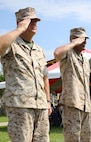 Lt. Gen. Robert B. Neller, commander of Marine Corps Forces Command, and Chief Warrant Officer 5 Nicholas V. Vitale, Ground Combat Element Integrated Task Force Gunner, salute as troops march by during the pass and review of Vitale's retirement ceremony June 18, 2015, at W.P.T. Hill Field, Marine Corps Base Camp Lejeune, North Carolina. Neller served as a mentor throughout Vitale's career, and was the reviewing officer for his ceremony. Vitale retired after serving more than 30 years of service in the Marine Corps. (U.S. Marine Corps photo by Alicia R. Leaders/Released)