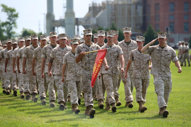 Marines of Company A, Ground Combat Element Integrated Task Force, render a salute during the pass and review of Chief Warrant Officer Nicholas V. Vitale's retirement ceremony June 18, 2015, at W.P.T. Hill Field, Marine Corps Base Camp Lejeune, North Carolina. Vitale retired after serving more than 30 years in the Marine Corps. (U.S. Marine Corps photo by Cpl. Paul S. Martinez/Released)