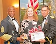 Three individuals were named Distinguished Troopers during the Victory Week 2015 Victory Dinner June 11. Flanked in this photo by Command Sgt. Maj. Maurice Jackson, left, and Brig. Gen. Eric J. Wesley, right, is Brianna Goff.  Each were recognized for contributions and support to the 1st Infantry Division, Fort Riley and its Soldiers.