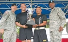 "Lt. Col Trent Upson, second from left, and Command Sgt. Maj. John Jones, third from left, 1st Battalion, 16th Infantry Regiment, 1st Armored Brigade Combat Team, 1st Infantry Division, command team, accept the Victory Cup trophy from Brig. Gen. Eric J. Wesley, 1st Inf. Div. acting senior mission commander, and Command Sgt. Maj. Maurice Jackson, the division's acting senior noncommissioned officer, during the Victory Week awards ceremony June 12 at Fort Riley's Custer Hill Parade Field. The ""Iron Rangers"" took the 2015 Victory Cup, accumulating the most points from sporting events."