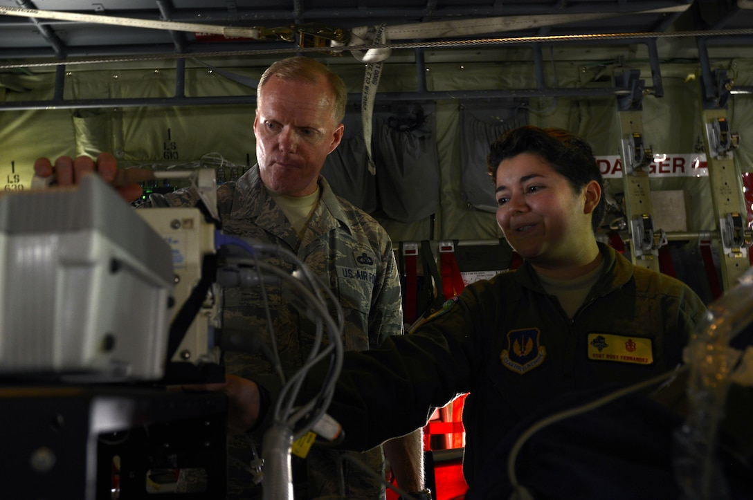 Staff Sgt. Rosy Fernandez, an 86th Medical Group respiratory therapist, demonstrates to Chief Master Sergeant of the Air Force James A. Cody how an injured military member receives care during an air rescue operation June 15, 2015, at Ramstein Air Base, Germany. During his visit, Cody held an all call for Airmen, spoke to senior NCOs and had a tour of Ramstein. (U.S. Air Force photo/Airman 1st Class Tryphena Mayhugh)