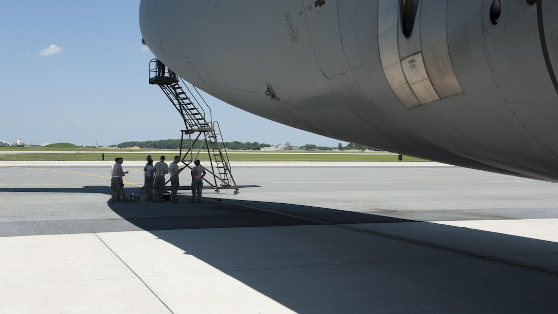 Senior Airman Joseph Carmona and Senior Airman Daniel Soto, both structural maintenance mechanics with the 436th Maintenance Squadron, apply an Air Force Reserve Command stencil to the side of a C-5M Super Galaxy June 22, 2015, at Dover Air Force Base, Del. Carmona and Soto also applied an Air Mobility Command stencil to the aircraft. (U.S. Air Force photo/Airman 1st Class Zachary Cacicia)