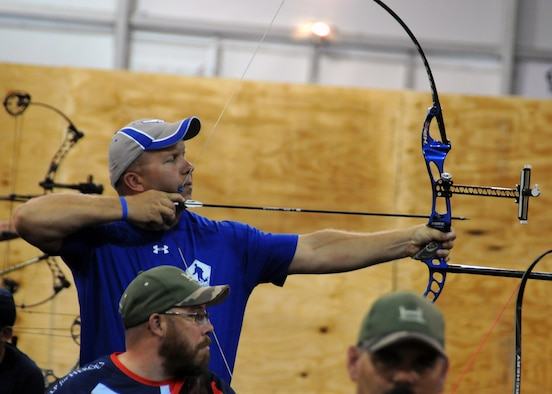 Retired Air Force Master Sgt. Craig Zaleski aims a recurve bow during the archery competition at the 2015 Department of Defense Warrior Games at Marine Corps Base Quantico, Va., June 22, 2015. Zaleski served 21 years as an aerospace group equipment technician. (Department of Defense photo/Shannon Collins)
