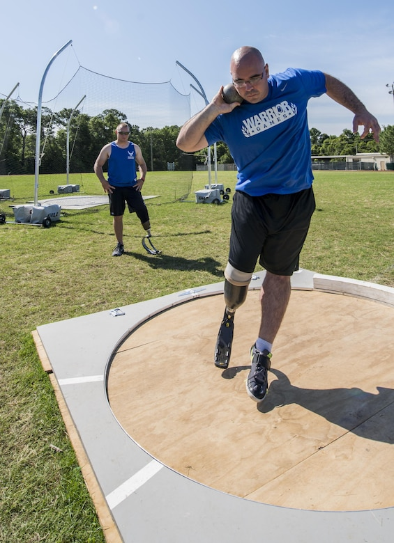 Tech. Sgt. Jason Caswell, an Air Force wounded warrior athlete, prepares to throw a shot put during the Warrior Games Training Camp at Eglin Air Force Base, Fla., April 20, 2015. The training camps, hosted by the U.S. Air Force Wounded Warrior Program, in coordination with Brig. Gen. David Harris, the 96th Test Wing commander, assist in recovery and promote mental and physical health, as well as teamwork. (U.S. Air Force photo/Maureen Stewart)