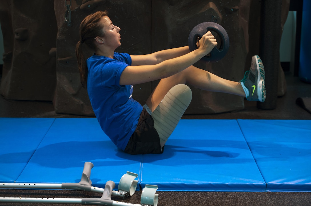 Capt. Christy Wise works out during the Intrepid Center ceremony at San Antonio Military Medical Center in San Antonio, Texas, June 12, 2015, as part of her recovery from an above-knee amputation. Wise competed in the 2015 Department of Defense Warrior Games just two months after losing her lower limb. (Department of Defense photo/EJ Hersom)
