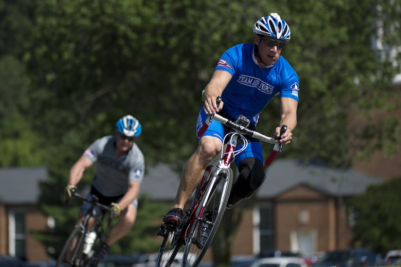 Staff Sgt. Ben Seekel turns a corner during a cycling competition at the 2015 Department of Defense Warrior Games on Marine Corps Base Quantico, Va., June 21, 2015. The Warrior Games features athletes from throughout the Defense Department who compete in Paralympic-style events for their respective military branches.  (Department of Defense photo/EJ Hersom)