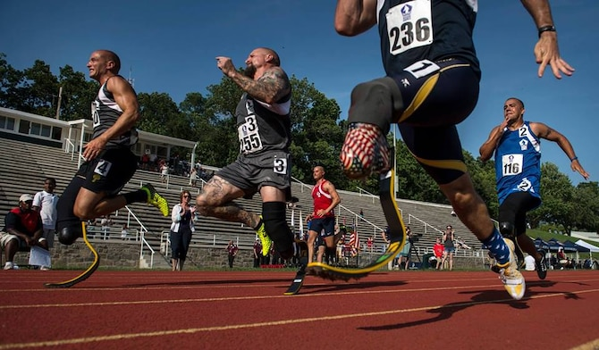 Staff Sgt. Rey Edenfield (far right), an Air Force wounded warrior athlete, sprints toward the finish line with fellow competitors at the 2015 Department Of Defense Warrior Games at the National Museum of the Marine Corps in Quantico, Va., June 23, 2015. The Warrior Games features athletes from throughout the Defense Department who compete in Paralympic-style events for their respective military branches.   (U.S. Air Force Photo/Staff Sgt. Vernon Young Jr.)
