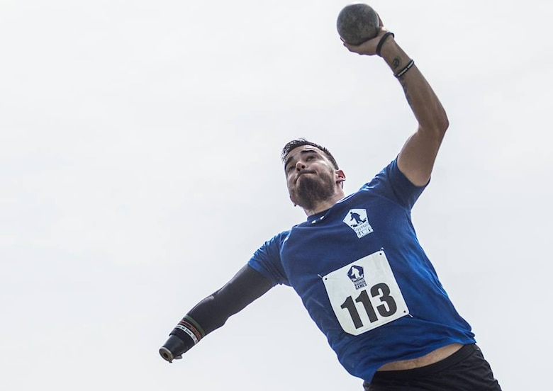 Retired Staff Sgt. Daniel Crane, an Air Force wounded warrior athlete, competes in the shot put at the 2015 Department of Defense Warrior Games at Marine Corps Base Quantico, Va., June 23, 2015. The Warrior Games features athletes from throughout the Defense Department who compete in Paralympic-style events for their respective military branches.  (U.S. Air Force Photo/Staff Sgt. Vernon Young Jr.)