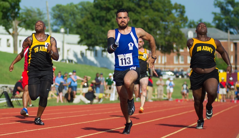 Retired Staff Sgt. Daniel Crane participates in the 100-meter sprint during the 2015 Department Of Defense Warrior Games at the National Museum of the Marine Corps in Quantico, Va., June 23, 2015. The Warrior Games features athletes from throughout the Defense Department who compete in Paralympic-style events for their respective military branches. (U.S. Marine Corps photo/Lance Cpl. Terry W. Miller Jr.)
