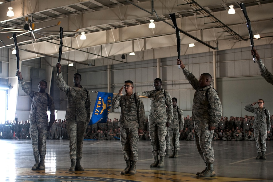 U.S. Air Force Airman 1st Class Matthew R. Ignacio, 316th TRS student and black corps commander, salutes to signify the end of the exhibition drill demonstration in the High Bay at the Louis F. Garland Fire Academy on Goodfellow Air Force Base, Texas, June 22, 2015. Ignacio worked with the other Airman to orchestrate a routine that won first place. (U.S. Air Force photo by Senior Airman Scott Jackson/Released)