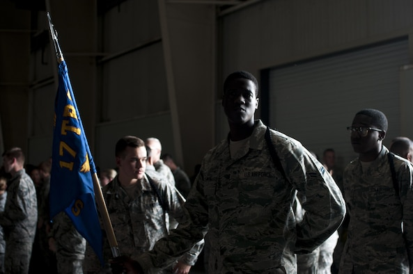 U.S. Air Force Airman 1st Class Brandon O. Agyemang, 316th Training Squadron student, stands with the guide-on awaiting the start of the drill competition in the High Bay at the Louis F. Garland Fire Academy on Goodfellow Air Force Base, Texas, June 22, 2015. The drill competition featured three teams competing against each other in two events. (U.S. Air Force photo by Senior Airman Scott Jackson/Released)